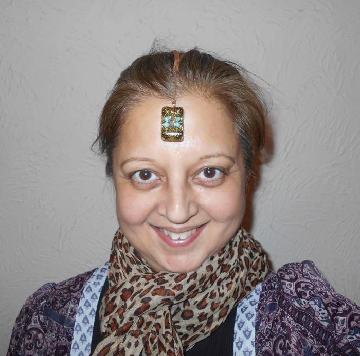 Neelu with crystal on forehead