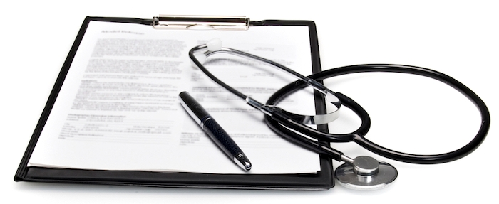 stethoscope and medical report