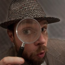 detective holding magnifying glass