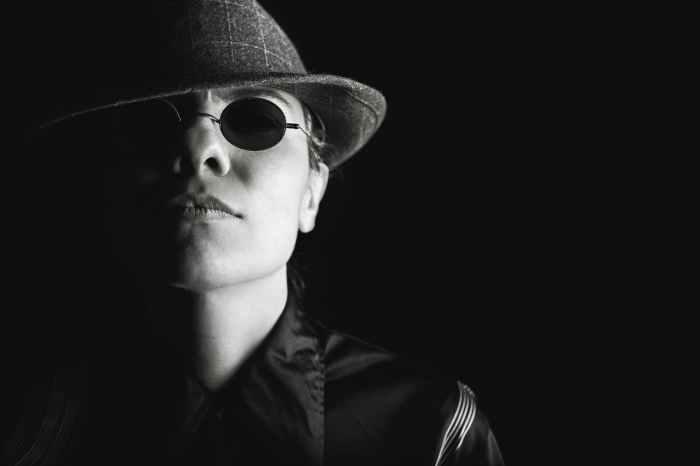 person sunglasses dark hat